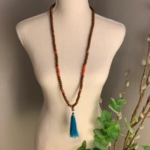 Jewelry - Wooden beaded necklace with teal tassel
